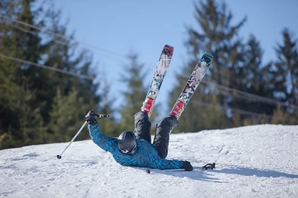 Skier falling on snow.