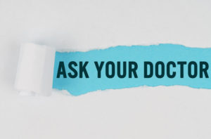 Photo illustration of torn paper with text that reads Ask Your Doctor.