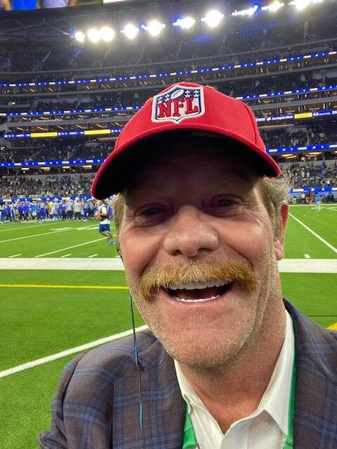 Dr. Johnson on sidelines at NFL game.